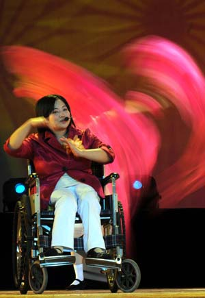 A handicapped artist rehearses on the Performing Arts Center stage in preparation for the 7th Guangxi Joint Performing Art Festival for the Disabled.