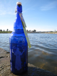 'Blue Hummingbird Lady, Bottle by the water, image design Catherine Herrera, 2008.