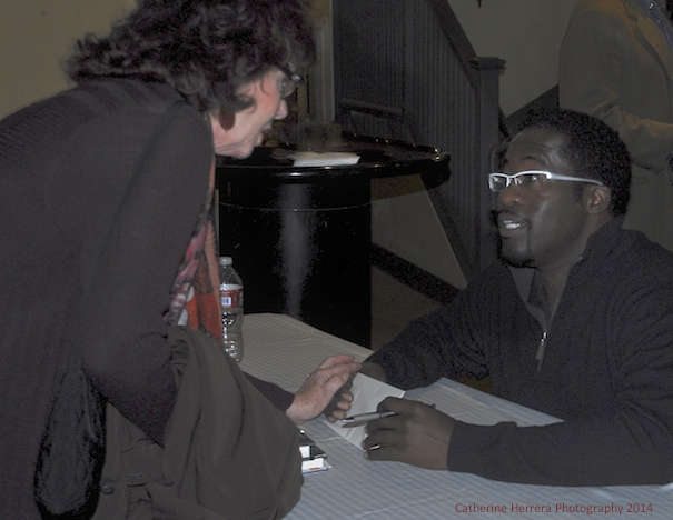 Actor, Singer and Performer Daniel Beaty signing a copy of his book 'Transforming Pain to Power' at the Brava Theater following a sold-out performance on Saturday April 5, 2014 in San Francisco, photo by Catherine Herrera, Intl CR Reserved. Contact for License